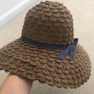 adjustable floppy straw hat with blue ribbon